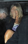 11.MARCH.2010 - LONDON<br /> <br /> ACTRESS JENNIFER ANISTON LEAVING THE AFTER PARTY FOR HER NEW FILM THE BOUNTY HUNTER AT ST. MARTINS LANE HOTEL LOOKING A LITTLE WORSE FOR WEAR WITH HER HANDS LOOKING VERY VEINY.<br /> <br /> BYLINE : EDBIMAGEARCHIVE.COM<br /> <br /> *THIS IMAGE IS STRICTLY FOR UK NEWSPAPERS & MAGAZINES ONLY*<br /> *FOR WORLDWIDE SALES OR WEB USE PLEASE CONTACT EDBIMAGEARCHIVE - 0044 208 954 5968*