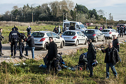 October 27, 2016 - Calais, France - A press conference is held on the sidelines of the jungle by the associations. The police rejected the protesters. Two demonstrators were arrested in Calais, October 27, 2016..The Calais jungle begins its fourth day of dismantling. Most refugees have left the jungle. Some roam the jungle and over 100 young refugees have no place in the Provisional Home Centre. The workers are destroying the jungle growing rapidly. (Credit Image: © Julien Pitinome/NurPhoto via ZUMA Press)