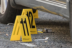 © Licensed to London News Pictures. 30/09/2017. London, UK. Police evidence markers are seen next to a cigarette packet and a plastic fork under a car after a man was fatally stabbed in Bow, East London. Police were called at 2:30 am on Saturday, 30 September to reports of a disturbance in E3. Officers found a 21-year-old man suffering from stab injuries. He was treated at the scene by London's Air Ambulance before being taken to an east London hospital where he died. Detectives from the Homicide and Major Crime Command are investigating. Photo credit: Peter Macdiarmid/LNP