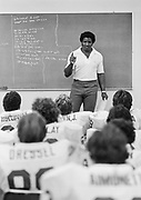 LOS ANGELES, CA - OCTOBER 11:  Coach Dennis Green, Stanford University Offensive Coordinator, meets with the Stanford football team offensive unit prior to a football game between UCLA and Stanford played on October 11, 1980 at the Los Angeles Memorial Coliseum in Los Angeles, California. (Photo by David Madison/Getty Images)