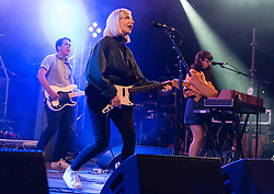 © Licensed to London News Pictures. 28/08/2015. Reading Festival, UK.  Alvvays  performing at Reading Festival 2015 28 August 2015 Day 1.  Alvvays is pronounced Always. In this picture - Brian Murphy (left), Molly Rankin (centre), Kerri MacLellan (right) Photo credit: Richard Isaac/LNP