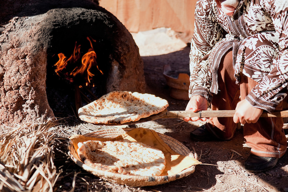 Baking traditional bread in a natural clay oven in rural Morocco.