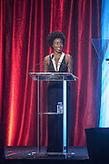 Kimberly Brooks, host and correspondent for Fusion Network, presents Jon Secada with the Muhammad Ali Humanitarian of the Year Award at the fourth annual Muhammad Ali Humanitarian Awards Saturday, Sept. 17, 2016 at the Marriott Hotel in Louisville, Ky. (Photo by Brian Bohannon for the Muhammad Ali Center)