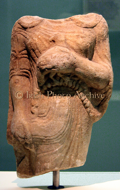 Kore (girl) holding a bead as an offering Marble, made in Ionia. From Theangela, Karia, made about 525-500BC. In Archaic Greek art the successful treatment of drapery was important in female statues, whereas the sculptors of male figures worked towards the ideal nude. This Kore wears a short- sleeved chiton (tunic) belted under the breasts, the material of which is pulled into shallow folds by the girl's right hand. Over this she has a himation (cloak) that falls over her back and is pinned at the shoulders.