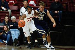 November 10, 2010; Stanford, CA, USA;  Stanford Cardinal guard Jeremy Green (45) dribbles past Cal State Monterey Bay Otters center James Albert (33) during the first half at Maples Pavilion.