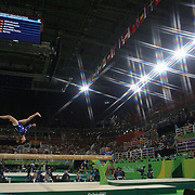 Gymnastics - Olympics: Day 2   Amy Tinkler #342 of Great Britain performing her routine on the Balance Beam during the Artistic Gymnastics Women's Team Qualification round at the Rio Olympic Arena on August 7, 2016 in Rio de Janeiro, Brazil. (Photo by Tim Clayton/Corbis via Getty Images)<br /> <br /> (Note to editors: A special effects starburst filter was used in the creation of this image)