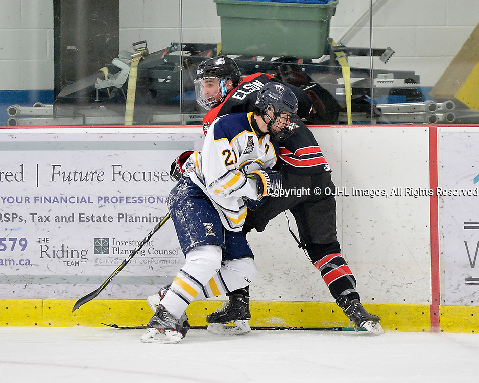 GEORGETOWN, ON  - NOV 4,  2017: Ontario Junior Hockey League game between the Georgetown Raiders and Buffalo Jr. Sabres. Adam Tretowicz #21 of the Buffalo Jr. Sabres and Zac Elson #4 of the Georgetown Raiders battle along the boards during the second period.<br /> (Photo by Shawn Muir / OJHL Images)
