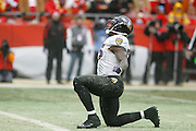 Terrell Suggs of the Baltimore Ravens celebrates after making a tackle against the Kansas City Chiefs during the AFC Wild Card Playoff game at Arrowhead Stadium on Jan. 9, 2011 in Kansas City, MO.