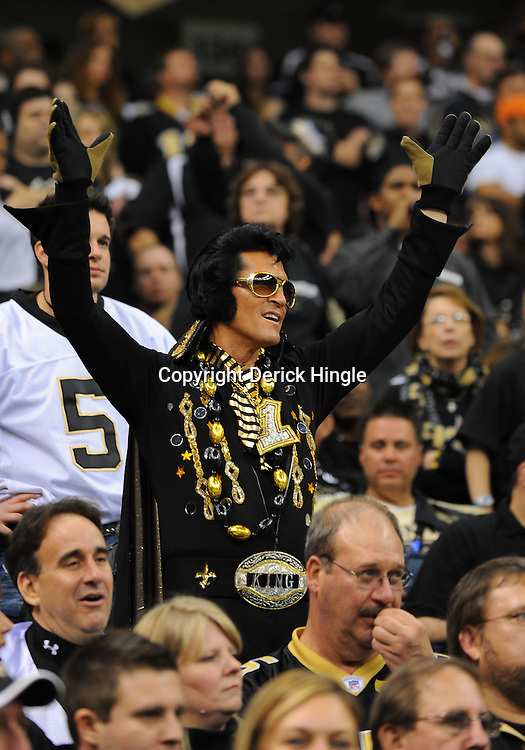 16 January 2010:  A New Orleans Saints fan dressed as Elvis cheers in the stands during a 45-14 win by the New Orleans Saints over the Arizona Cardinals in the 2010 NFC Divisional Playoff game at the Louisiana Superdome in New Orleans, Louisiana.