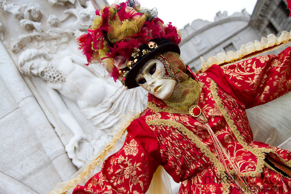 People with mask and fancy dress in  carnival. Venice, Italy.