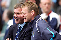 Photo: Daniel Hambury.<br /> Manchester City v West Bromich Albion. Barclaycard Premiership. 13/08/2005.<br /> Manchester City's Stuart Pearce and West Brom's Brian Robson share a joke before kick off.