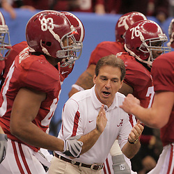 2 January 2009: Alabama head coach Nick Saban talks to his team prior to kickoff of the 75th annual All State Sugar Bowl  between the Utah Utes and the Alabama Crimson Tide at the Louisiana Superdome in New Orleans, LA.