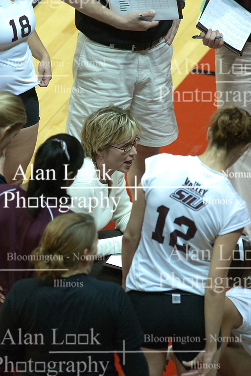 29 October 2005: Salukis coach Brenda Winkeler talks to her team during a time out. In three games, the Illinois State Redbirds ran past the Salukis of Southern Illinois University. The matchup took place at Redbird Arena on the campus of Illinois State University in Normal IL