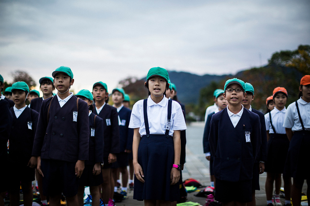 Young students sing a song near Ground Zero of the atomic bomb attack in Nagasaki, Japan.