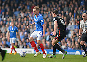 Portsmouth striker Adam McGurk holds off Carlisle United Midfielder Luke Joyce during the Sky Bet League 2 match between Portsmouth and Carlisle United at Fratton Park, Portsmouth, England on 2 April 2016. Photo by Adam Rivers.