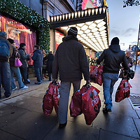 London December 26 Early bargain hunters walk in front of Selfridges queue on Oxford Street. More than 50,000 people will pass through the doors at Selfridges and the store expect to take in excess of £1M per hour at peak time on the first day of this year Sales...***Agreed Fee's Apply To All Image Use***.Marco Secchi /Xianpix. tel +44 (0) 771 7298571. e-mail ms@msecchi.com .www.marcosecchi.com