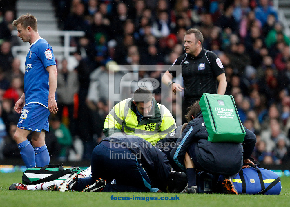 Picture by Daniel Chesterton/Focus Images Ltd. 07966 018899.09/04/12.George McCartney of West Ham lays injured during the Npower Championship match at the Boleyn Ground stadium, London.