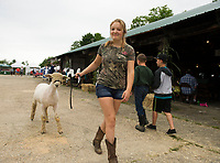 "Morganne Moses with ""Toby"" entered in the showing for the Market Lamb class during the 4H Fair at the Belmont Fairgrounds Saturday.  (Karen Bobotas/for the Laconia Daily Sun)"