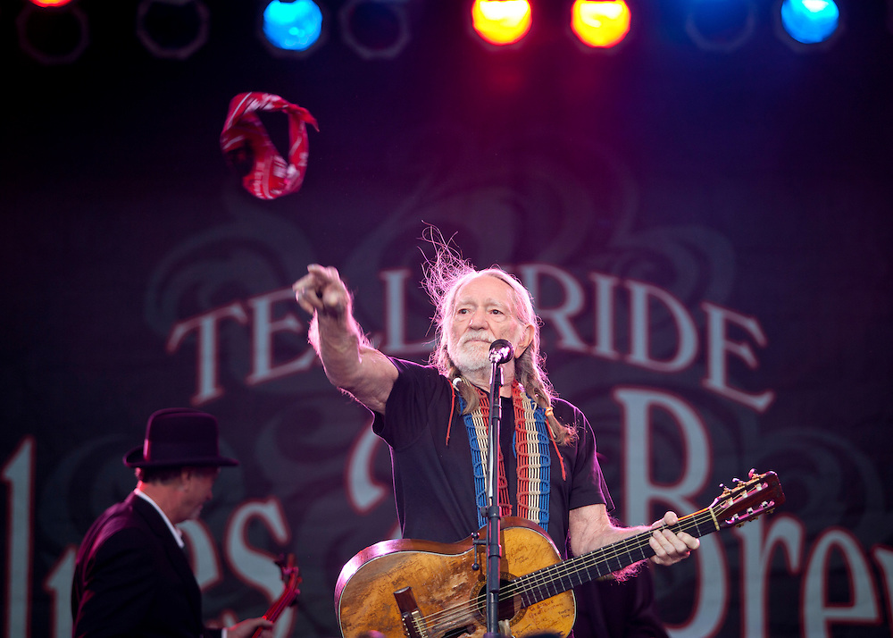 Wille Nelson tosses his bandana to the crowd gathered for the final act at the the Telluride Blues and Brews Festival.