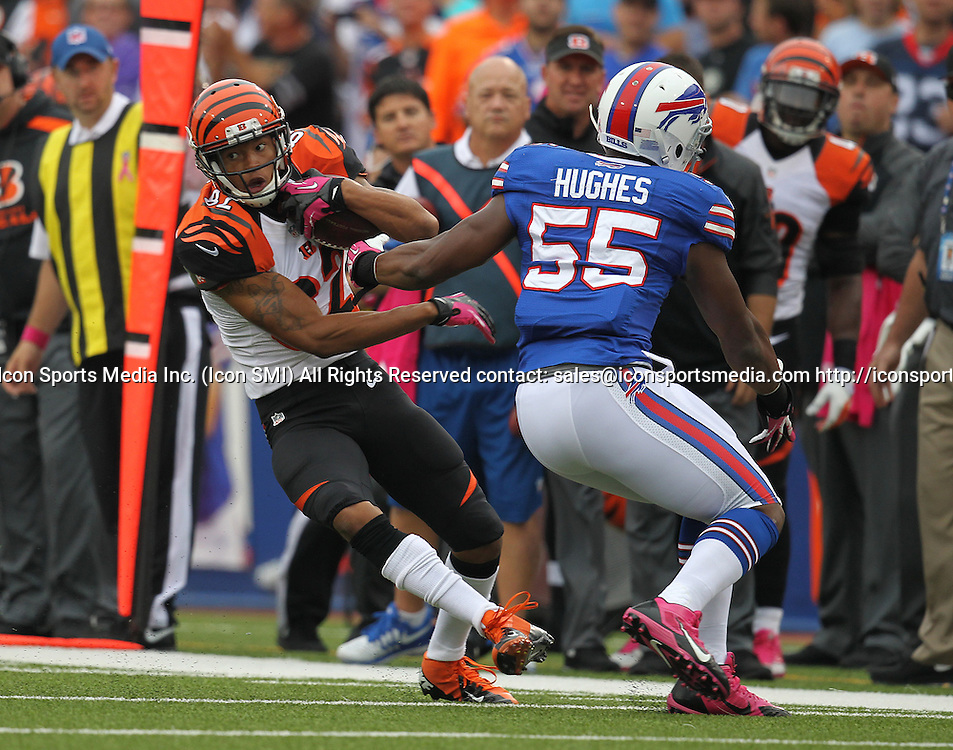 13 October 2013: Cincinnati Bengals wide receiver Marvin Jones (82) side steps Buffalo Bills outside linebacker Jerry Hughes (55) during a NFL game between the Cincinnati Bengals and Buffalo Bills at Ralph Wilson Stadium in Orchard Park, NY.
