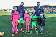 Mascots with Forest Green Rovers Dan Wishart(17) and Forest Green Rovers Omar Bugiel(11) during the EFL Sky Bet League 2 match between Forest Green Rovers and Cheltenham Town at the New Lawn, Forest Green, United Kingdom on 25 November 2017. Photo by Shane Healey.