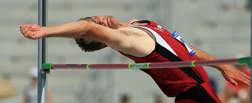"""11 JUNE 2008: Stanford decathlete Josh Hustedt eyes the bar set at 6' 4""""in the high jump Wednesday as he make a clearance worth 740 points. The NCAA Division 1 Men's and Women's Track & Field Championships in Des Moines, Iowa, was in it's first of four days of competition.  David Peterson"""