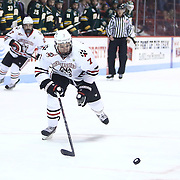 Mike McMurtry #7 of the Northeastern Huskies skates to the puck during the game at Matthews Arena on January 18, 2014 in Boston, Massachusetts. (Photo by Elan Kawesch)