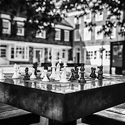 A black and white photo of a chess table on the Green of Palmer Square in Princeton New Jersey