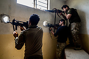 Iraqi soldiers take aim at ISIS positions in the Al Thawra neighborhood. West Mosul, Iraq. Apr. 19, 2017. (Photo by Gabriel Romero ©2017)