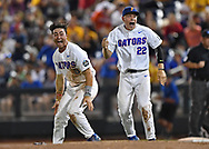 Players J.J. Schwarz #22 and Jonathan India #6 of the Florida Gators celebrate after beating the LSU Tigers 6-1 to win the National Championship at the College World Series at TD Ameritrade Park in Omaha, Nebraska.